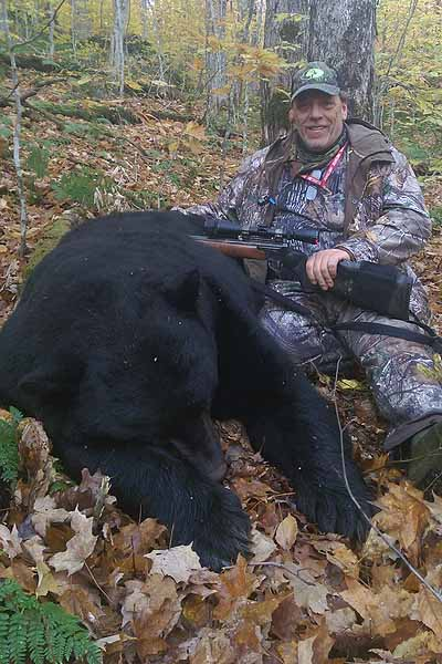 This 425-pound black bear was taken by Wayne Cobler of the Horseshoe Lake Hunging Club near Piercefield in St. Lawrence County. It toos six men six hours to carry the bear a half-mile to a trail where it was later carted out of the woods.