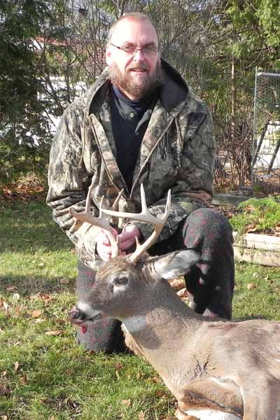 John Greco with a 130-pound, 9-pointer taken Nov. 21 in Hogtown, Washingon County