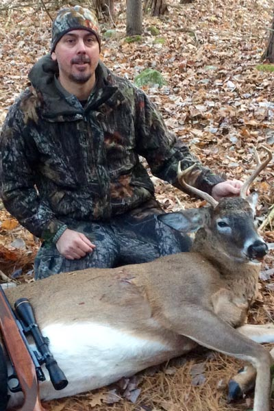 Dustin St. Andrews of Glens Falls with a 6-pointer taken in Jefferson County on Nov. 18
