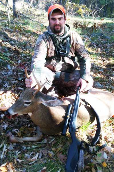 Travis Sherman of Moriah with a 4-pionter takend during the early muzzleloading season.