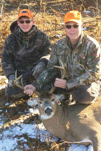2016: Robert and Jacob Berben with a 158-pound, 8-pointer taken in Fulton county